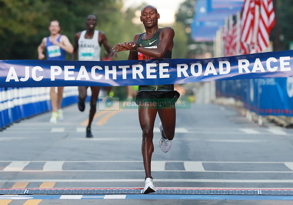 July 4, 2018 - Atlanta, GA, USA - Bernard Kip Lagat wins the AJC Peachtree Road Race with a time of 28:45 in the 10K race on Wednesday, July 4, 2018, in Atlanta. (Credit Image: © Curtis Compton/TNS via ZUMA Wire)