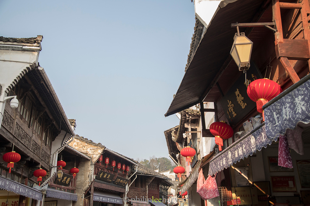 View of ornate architecture and Chinese lanterns in the street in an old town, Old Street, Tunxi district, Huangshan City, Anhui Province, China