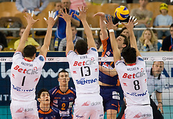 Andrej Flajs of ACH vs Matey Kaziyski (1), Riad Ribeiro Garcia Pires (13) and Neves Leandro Vissotto of Trentino at 2nd Semifinal match of CEV Indesit Champions League FINAL FOUR tournament between ACH Volley, Bled, SLO and Trentino BetClic Volley, ITA, on May 1, 2010, at Arena Atlas, Lodz, Poland. (Photo by Vid Ponikvar / Sportida)