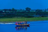 Ferry boats crossing the Yamuna River at Gotam Nagar, Vrindavan, Uttar Pradesh, India.