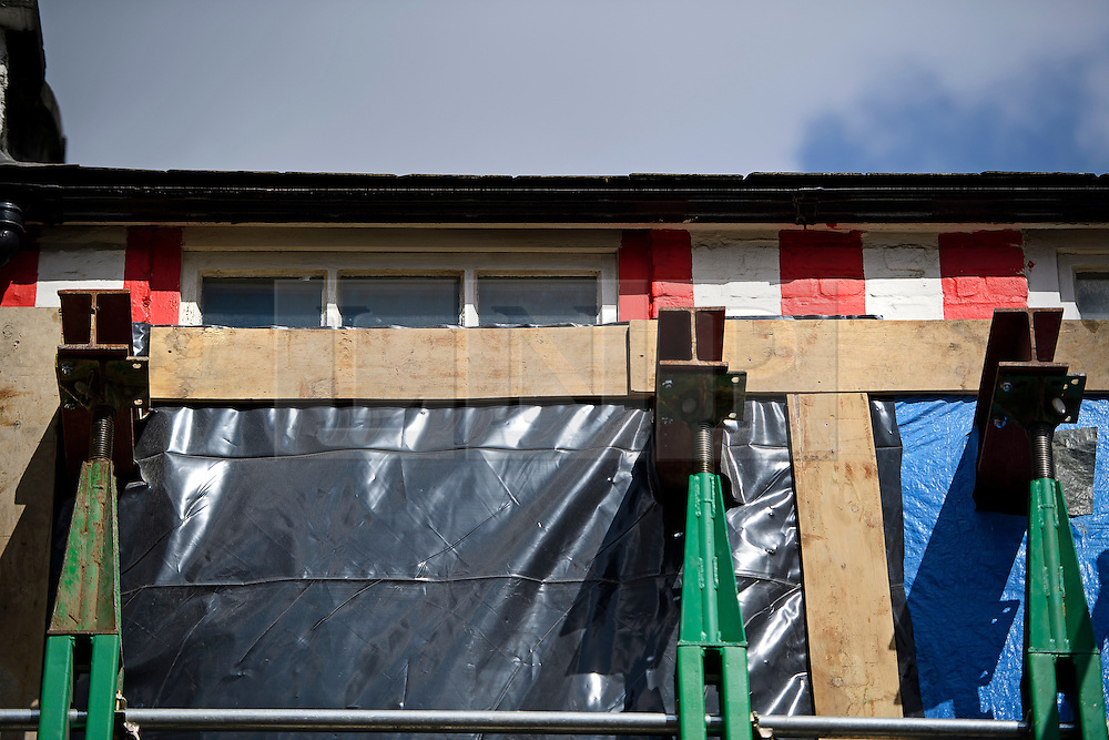 © London News Pictures. 27/04/2016. A detail showing a red stripes persuading above covers placed over the building during works. A house painted with red and white stripes in the Kensington area of west London which is currently being demolished and then rebuilt. The candy stripes were originally painted on to the multi-million pound house following a dispute in which  neighbours objected to plans to demolish the building and replace it with a new house and two-storey basement. Photo credit: Ben Cawthra/LNP