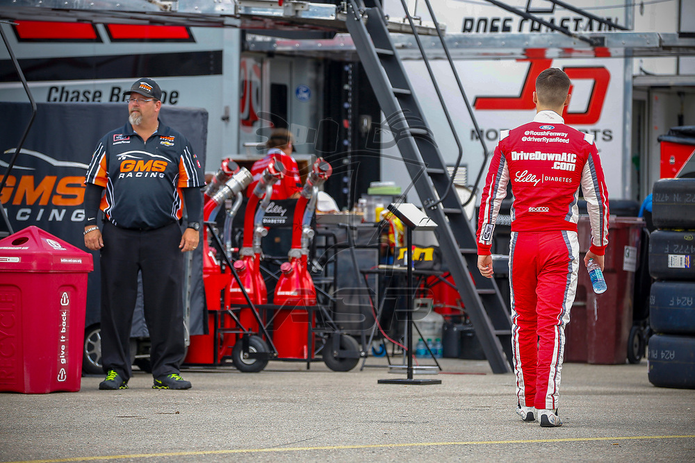 Ryan Reed (16) hangs out in the garage during practice for the US Cellular 250 at Iowa Speedway in Newton, Iowa.