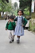 Young children in uniform on the way to school Darjeeling, West Bengal, India