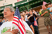 "May 29 - TEMPE, AZ: People recite the Pledge of Allegiance at the start of a rally against illegal immigration in Tempe, AZ, Saturday. About 3,000 people attended a ""Buy Cott Arizona"" rally at Tempe Diablo Stadium in Tempe, AZ Saturday night. The rally was organized by members of the Arizona Tea Party movement to show support for Arizona law SB1070. The ""Buy Cott"" is a reaction to the economic boycott planned by opponents of SB1070. SB1070 makes it an Arizona state crime to be in the US illegally and requires that immigrants carry papers with them at all times and present to law enforcement when asked to. Critics of the law say it will lead to racial profiling, harassment of Hispanics and usurps the federal role in immigration enforcement. Supporters of the law say it merely brings Arizona law into line with existing federal laws.  Photo by Jack Kurtz"