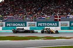 October 1, 2017 - Sepang, Malaysia - Motorsports: FIA Formula One World Championship 2017, Grand Prix of Malaysia, ..#20 Kevin Magnussen (DNK, Haas F1 Team), #30 Jolyon Palmer (GBR, Renault Sport F1 Team) (Credit Image: © Hoch Zwei via ZUMA Wire)