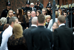 © Licensed to London News Pictures . 15/07/2016 . Bolton , UK . Mourners gather outside the church , ahead of the service . The funeral of Special Constable Samantha Derbyshire at St Mary's RC Church in Horwich , Bolton. Derbyshire was struck and killed by an HGV on the M61 motorway following a collision , in the early hours of Monday 11th July 2016 . Photo credit : Joel Goodman/LNP