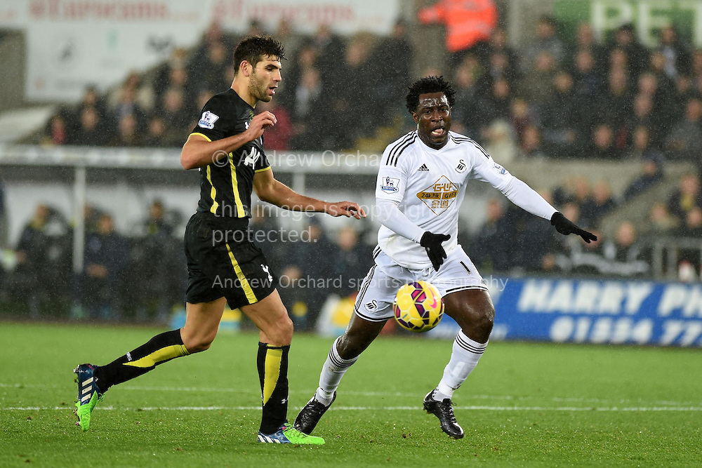 Federico Fazio of Tottenham (l) challenges Swansea city's Wilfried Bony. .Barclays Premier League match, Swansea city v Tottenham Hotspur at the Liberty Stadium in Swansea, South Wales on Sunday 14th December 2014<br /> pic by Andrew Orchard, Andrew Orchard sports photography.