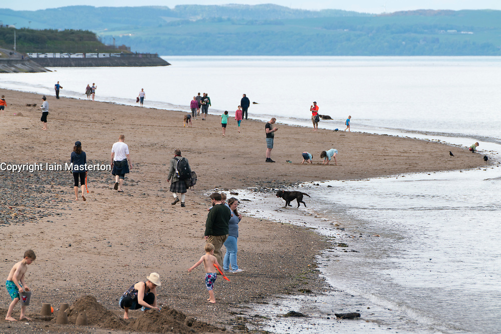 Portobello, Scotland, UK. 9 May 2020. Images from holiday weekend Saturday afternoon during Covid-19 lockdown on promenade at Portobello. Promenade and beach were relatively quiet with a low key police presence. Pictured;  View of people and families on beach.  Iain Masterton/Alamy Live News
