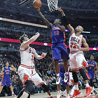30 March 2012: Detroit Pistons point guard Will Bynum goes for the layup past Chicago Bulls forward Taj Gibson (22) and Chicago Bulls center Omer Asik (3) during the Chicago Bulls 83-71 victory over the Detroit Pistons at the United Center, Chicago, Illinois, USA. NOTE TO USER: User expressly acknowledges and agrees that, by downloading and or using this photograph, User is consenting to the terms and conditions of the Getty Images License Agreement. Mandatory Credit: 2012 NBAE (Photo by Chris Elise/NBAE via Getty Images)