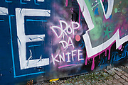 Graffiti against knife crime in Digbeth on 3rd August 2021 in Birmingham, United Kingdom. In 2020, there were approximately 46,000 recorded knife crimes in the UK, which is a doubling of the figures since 2013. While some areas in the UK have recorded dramatic falls in knives used in crimes, some areas have significantly risen.