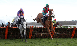 Eventual winner First Drift ridden by Max Kendrick (right) jumps the last with Betameche ridden by Harry Skelton in the Peter O'Sullevan Charitable Trust H.O.P.E Programme Seniors' Handicap Hurdle at Newbury Racecourse.