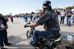 Rowdy Schenck of New Mexico goes over the finish line in Dodge City, KS on his 1915 Harley-Davidson during the Motorcycle Cannonball Race of the Century. Stage-8 from Wichita, KS to Dodge City, KS. USA. Saturday September 17, 2016. Photography ©2016 Michael Lichter.