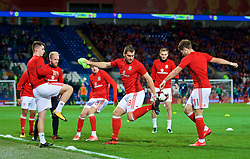 CARDIFF, WALES - Monday, October 9, 2017: Wales' Sam Vokes during the pre-match warm-up before the 2018 FIFA World Cup Qualifying Group D match between Wales and Republic of Ireland at the Cardiff City Stadium. Ben Woodburn, Jonathan Williams, Tom Bradshaw (Pic by Paul Greenwood/Propaganda)