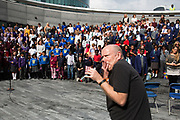 Kids choir, made from schools from all over the region, perform at The Scoop. Totally Thames takes place over the whole month in September, combining arts, cultural and river events presented by Thames Festival Trust throughout the 42-mile stretch of the River Thames in London, UK.