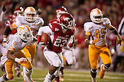 Nov 12, 2011; Fayetteville, AR, USA;  Arkansas Razorbacks runningback De'Anthony Curtis (23) carries the ball past Tennessee Volunteers defensive back Izauea Lanier (18) and linebacker A.J. Johnson (45) during a game at Donald W. Reynolds Razorback Stadium. Arkansas defeated Tennessee 49-7. Mandatory Credit: Beth Hall-US PRESSWIRE