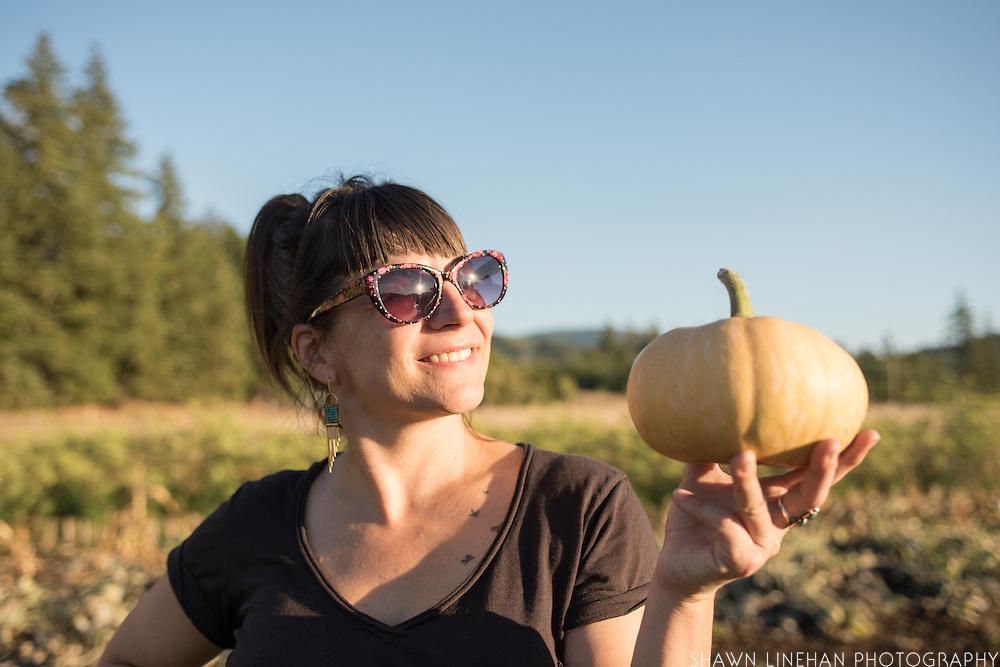 Lane Selman of Culinary Breeding Networks admires a Doran Round Butternut squash from Adaptive Seeds Farm.