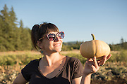 Lane Selman of Culinary Breeding Networks admires a Doran Round Butternut squash from Adaptive Seeds Farm.