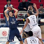 Anadolu Efes's Cenk AKYOL (R) during their Turkish Airlines Euroleague Basketball Group C Game 2 match Anadolu Efes between Belgacom Spirou  at Abdi Ipekci Arena in Istanbul, Turkey, Wednesday, October 26, 2011. Photo by TURKPIX