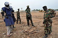 MAG deminers and SPLA officers examin a huge number of unexploded ordinance found scattered across a large, open terrain just opposite John Garang's tomb in Juba as the area was being prepared for South Sudan independence ceremonies. The Government of South Sudan called on Mines Advisory Group (MAG) to assist SPLA deminers in an attempt to clear the area and make it safe for the thousands of people and dignitaries who will be attending the declaration of independence on July 9th...Juba, South Sudan. 04/07/2011..Photo © J.B. Russell