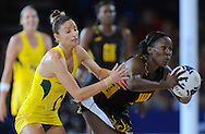Commonwealth Games, Glasgow 2014<br /> SECC Netball Semi Final<br /> <br /> Australia v Jamaica.<br /> Kimberlee Green of Australia (GOLD) and Sasher- Gaye Henry of Jamaica<br /> <br />  Neil Hanna Photography<br /> www.neilhannaphotography.co.uk<br /> 07702 246823