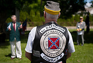 21 MAY 2017 -- BRIDGETON, Mo. -- Gary Mayden (center), a member of the Sons of Confederate Veterans, listens as Bob Arnold (left) delivers the keynote address during the annual Confederate Memorial Day remembrance held at Fee Fee Cemetery in Bridgeton Sunday, May 21, 2017. The event is sponsored by the James Morgan Utz Camp 1815 of the Sons of Confederate Veterans and the Gen. Francis Marion Cockrell Chapter 84 of the Military Order of Stars and Bars and is held at the gravesite of Col. James Utz, a Confederate soldier from Missouri who was convicted of spying and executed in St. Louis Dec. 26, 1864. Photo © copyright 2017 Sid Hastings.