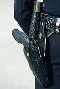 Los Angeles police force revolver gun in its black leather and silver holster alongside a truncheon RESERVED USE - NOT FOR DOWNLOAD -  FOR USE CONTACT TIM GRAHAM