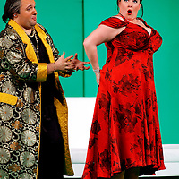 Picture shows :  Tiziano Bracci as Mustafa  and Karen Cargill as Isabella ..Picture  ©  Drew Farrell Tel : 07721 -735041..A new Scottish Opera production of  Rossini's 'The Italian Girl in Algiers' opens at The Theatre Royal Glasgow on Wednesday 21st October 2009..(Soap) opera as you've never seen it before.Tonight on Algiers.....Colin McColl's cheeky take on Rossini's comic opera is a riot of bunny girls, beach balls, and small screen heroes with big screen egos. Set in a TV studio during the filming of popular Latino soap, Algiers, the show pits Rossini's typically playful and lyrical music against the shoreline shenanigans of cast and crew. You'd think the scandal would be confined to the outrageous storylines, but there's as much action off set as there is on.....Italian bass Tiziano Bracci makes his UK debut in the role of Mustafa. Scottish mezzo-soprano Karen Cargill, who the Guardian called a 'bright star' for her performance as Rosina in Scottish Opera's 2007 production of The Barber of Seville, sings Isabella..Cast .Mustafa...Tiziano Bracci.Isabella..Karen Cargill.Lindoro...Thomas Walker.Elvira...Mary O'Sullivan.Zulma...Julia Riley.Haly...Paul Carey Jones.Taddeo...Adrian Powter..Conductors.Wyn Davies.Derek Clarke (Nov 14)..Director by Colin McColl.Set and Lighting Designer by Tony Rabbit.Costume Designer by Nic Smillie..New co-production with New Zealand Opera.Production supported by.The Scottish Opera Syndicate.Sung in Italian with English supertitles..Performances.Theatre Royal, Glasgow - October 21, 25,29,31..Eden Court, Inverness - November 7. .His Majesty's Theatre, Aberdeen  - November 14..Festival Theatre,Edinburgh - November 21, 25, 27 ...Note to Editors:  This image is free to be used editorially in the promotion of Scottish Opera. Without prejudice ALL other licences without prior consent will be deemed a breach of copyright under the 1988. Copyright Design and Patents Act  and will be subject to payment or legal action, where appropriate..Fur