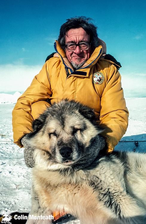 New Zealand mountaineer and Scott Base leader Norman Hardie with Scott base husky, Ross island, Antarctica.
