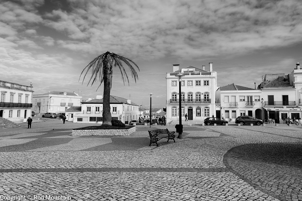 Nazaré, Portugal - February 12, 2018 - Nazaré Plaza 01 - A spacious public square in Nazaré is situated near the Santuário de Nossa Senhora da Nazaré and has beautiful views of Nazaré and it's beach. Café do Largo and Clínica do Sítio are seen in the distance. <br /> <br /> Image: © Rod Mountain<br /> <br /> http://www.rodmountain.com<br /> http://bit.ly/Nazaré_bw<br /> http://bit.ly/Nazare_Portugal<br /> <br /> @nikoncanada #NikonCA<br /> @NikonUSA #NikonNoFilter<br /> @nikoneurope #NikonEurope @visitportugal <br /> #turismoemportugal #turismo #rotaportugal <br /> #BBCTravel #nakedplanet #VirtuosoTravel #Fodorsonthego #TLPicks #tourism  #stayandwander<br /> #TravelAwesome #nakedplanet #Travelingpost #worldcaptures <br /> #bw_awards  #bwmasters #bnwsouls #bnw_zone   #photooftheday #instatraveling #ignanttravel #everydayportugal <br /> #blackandwhitephotography #photooftheday #bwmasters  #bnw_greatshots #bw_photooftheday<br /> <br /> https://en.wikipedia.org/wiki/Portugal https://en.wikipedia.org/wiki/Nazaré,_Portugal<br /> http://www.cm-nazare.pt/en<br /> https://www.visitportugal.com/en<br /> https://en.wikipedia.org/wiki/Sanctuary_of_Our_Lady_of_Nazaré