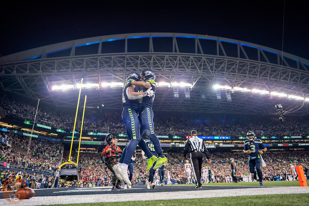 December 29, 2019; Seattle, Washington, USA; Seattle Seahawks wide receiver D.K. Metcalf (14, left) is congratulated by wide receiver Tyler Lockett (16, right) after scoring a touchdown during the fourth quarter against the San Francisco 49ers at CenturyLink Field.