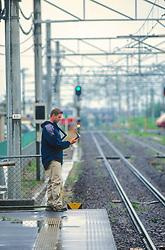 J. Nichols Checking GPS At Train Station