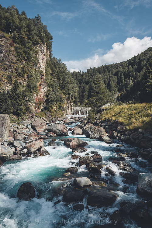 Mountain river Mallero in the Italian Alps on a Summer day