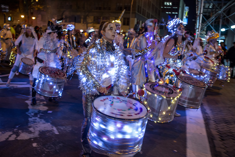 New York, NY - 31 October 2015. A drum line made up of energetic women from the Batala NYC Samba Reggae Drum Band in the annual Greenwich Village Halloween Parade. The Afro-Brazilian band is composed entirely of women.