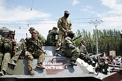 © Licensed to London News Pictures. Donetsk 29/05/14. Vostok Battalion, a Russian military unit based in Chechnya, is now in control of Donetsk government Building. Here they parade on Election Day in Lenin Square. Photo credit : Christopher Nunn/LNP