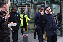 London, UK. 13th February, 2019. Outsourced workers belonging to the Public & Commercial Services union (PCS) walk out from the Department of Business, Energy and Industrial Strategy (BEIS) for their second day of strike action to demand the London Living Wage and an end to outsourcing. Union members handed out strike-themed cakes to supporters in return for donations to the strike fund.