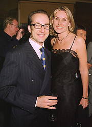 MISS CLARE STAPLES and MR PAUL McKENNA the hypnotist, at a dinner in London on 20th July 1998.MJE 19