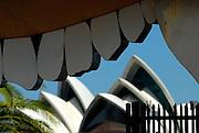 "Sydney Opera House viewed through ""mouth"" of Luna Park entrance. Sydney, Australia"