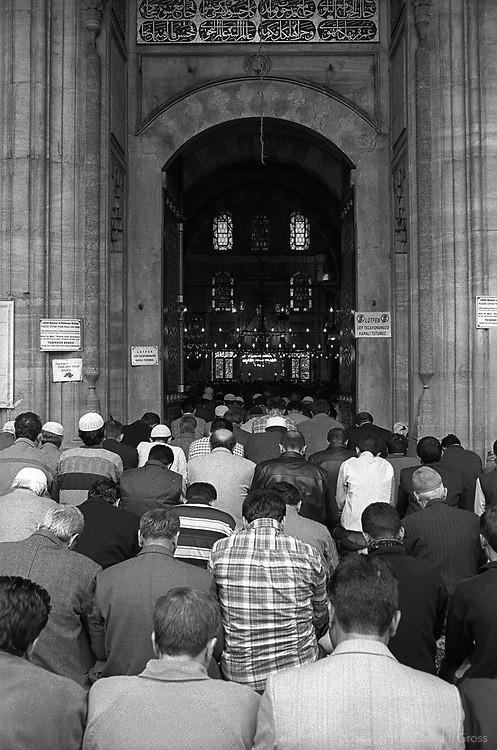 Midday prayer on the first Friday of the Muslim holy month of Ramadan at the Yeni Mosque (Valide Mosque) in Istanbul, Turkey.
