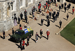 The Prince of Wales, the Duke of York, the Duke of Cambridge, Peter Phillips, the Princess Royal, the Earl of Wessex, the Duke of Sussex, the Earl of Snowdon and Vice-Admiral Sir Timothy Laurence follow the Duke of Edinburgh's coffin, covered with his Personal Standard, on the purpose built Land Rover Defender during the Ceremonial Procession ahead of the funeral of the Duke of Edinburgh in Windsor Castle, Berkshire. Picture date: Saturday April 17, 2021.