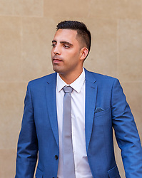 © Licensed to London News Pictures. 06/08/2018. Bristol, UK.  RYAN ALI leaving Bristol Crown court today for the start of his trial on charges of affray that relate to a fight outside a Bristol nightclub on September 25 2017. England cricketer Ben Stokes and two other men, Ryan Ali, 28, and Ryan Hale, 27, all deny the charge. Stokes, Ali and Hale are jointly charged with affray in the Clifton Triangle area of Bristol on September 25 last year, several hours after England had played a one-day international against the West Indies in the city. A 27-year-old man allegedly suffered a fractured eye socket in the incident. Photo credit: Simon Chapman/LNP