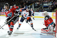 KELOWNA, CANADA, OCTOBER 29: Logan McVeigh #12 of the Kamloops Blazers looks for the pass as Mitchell Chapman #5 and Adam Brown #1 of the Kelowna Rockets defend the net as the Kamloops Blazers visit the Kelowna Rockets  on October 29, 2011 at Prospera Place in Kelowna, British Columbia, Canada (Photo by Marissa Baecker/Shoot the Breeze) *** Local Caption *** Logan McVeigh;Mitchell Chapman; Adam Brown;