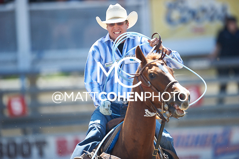Team roper Garrett Jess of Coulee City, WA competes at the Redding Rodeo in Redding, CA.<br /> <br /> <br /> UNEDITED LOW-RES PREVIEW<br /> <br /> <br /> File shown may be an unedited low resolution version used as a proof only. All prints are 100% guaranteed for quality. Sizes 8x10+ come with a version for personal social media. I am currently not selling downloads for commercial/brand use.