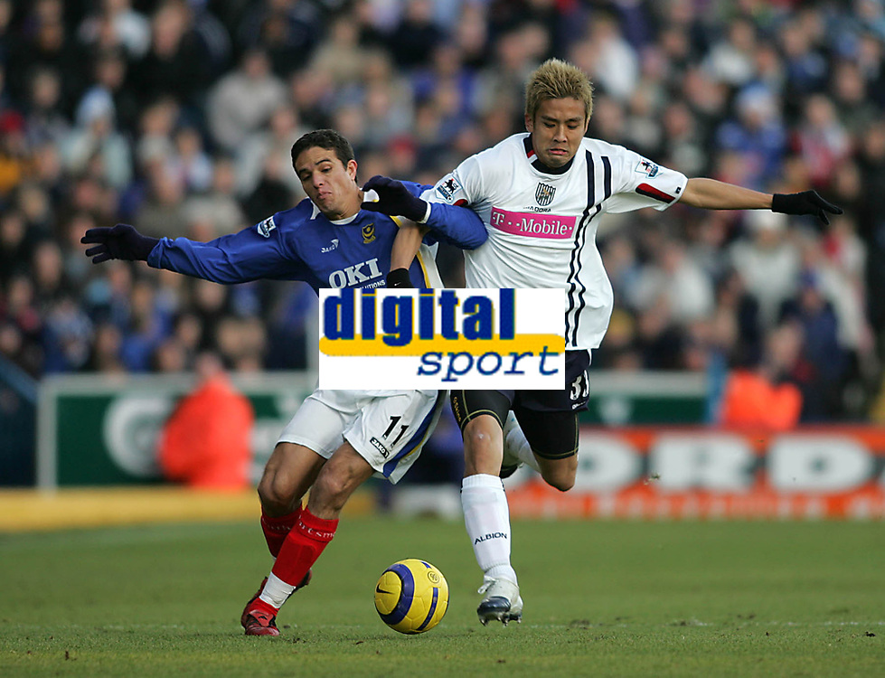 Photo: Lee Earle.<br /> Portsmouth v West Bromwich Albion. The Barclays Premiership. 17/12/2005. Portsmouth's Laurent Robert (L) battles with Junichi Inamoto.
