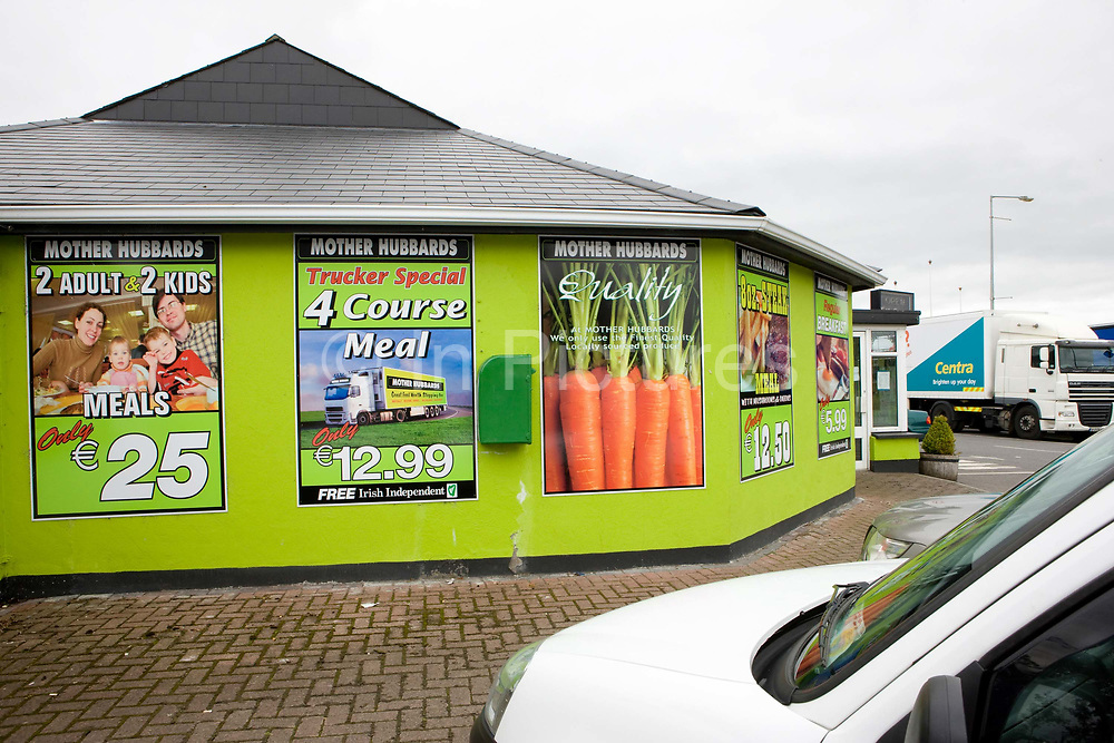 Discount posters line the exterior walls of Mother Hubbard's roadside truck stop on the 28th July 2011 in Moyvally in the Republic Of Ireland.