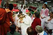 Twee bezoekers ondergaan de darshan, oftewel de omhelzing, door Amma. In de Expo in Houten is Mata Amritanandamayi, beter bekend als Amma of 'hugging mother', aanwezig om mensen te omhelzen en te inspireren. Het driedaags benefiet in Houten is het grootste spirituele festival in Nederland en zal naar verwachting 15.000 bezoekers trekken.<br /> <br /> Two visitor are receiving the darshan from Amma. In the Expo in Houten people are gathering to get a darshan, or hug, by  Mata Amritanandamayi, also known as Amma or 'hugging mother'. Amma is travelling through the world to hug people for inspiring them to make a better world. Amma is one of the twelve most influence spiritual leaders of the world. The event in Houten lasts for three days and is the biggest spiritual event of The Netherlands.