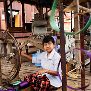 Woman weavin silk at traditional workshop at Inle Lake