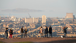 Edinburgh, Scotland, UK. 26 February, 2019. Tourists enjoy view of Leith from Calton Hill in Edinburgh after a warm clear day with temperatures reaching 13C.