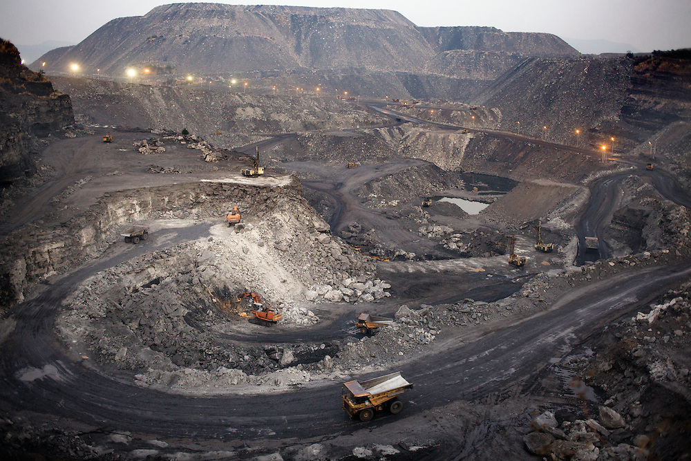 The Tata coal mine at West Bokaro. Most of those employed at the mine are not from the locally displaced Adivasi communtiy so must find work in peripheral businesses of migrate in search of employment. ..Photo: Tom Pietrasik.Jharkhand, India.January 31st 2010