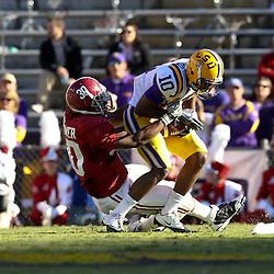 November 6, 2010; Baton Rouge, LA, USA; Alabama Crimson Tide linebacker Dont'a Hightower (30) tackles LSU Tigers wide receiver Russell Shepard (10) during the first half at Tiger Stadium. LSU defeated Alabama 24-21.  Mandatory Credit: Derick E. Hingle