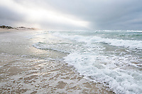 Wave break on the coast during a winter storm, De Mond Nature Reserve, Western Cape, South Africa